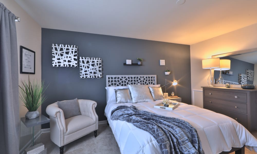 Enjoy a well decorated bedroom at Princeton Estates Apartment Homes in Temple Hills