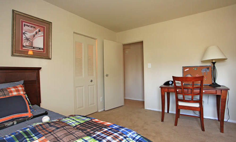 Enjoy a cozy bedroom at Carriage Hill Apartment Homes