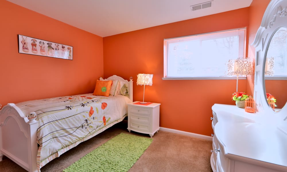 Gwynn Oaks Landing Apartments & Townhomes offers a well decorated bedroom in Baltimore