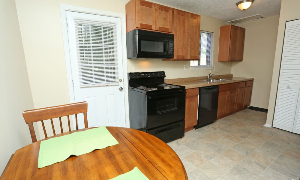 Kitchen room with dining table at Victoria Gardens Apartments in Louisville, Kentucky