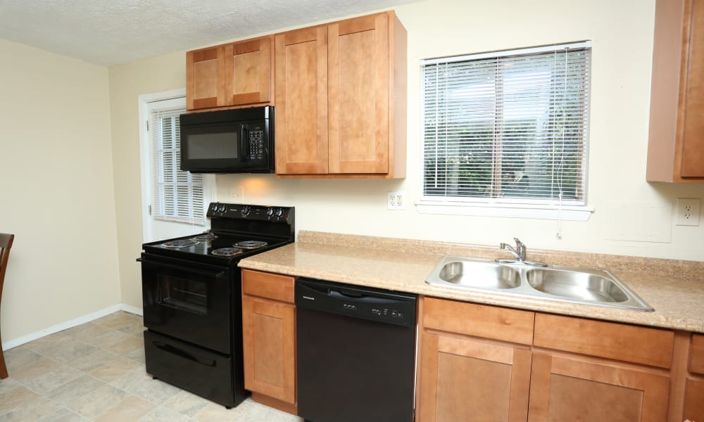 Victoria Gardens Apartments offers a kitchen in Louisville, Kentucky