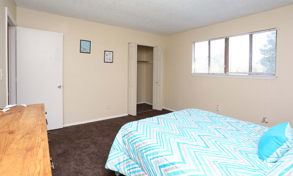 Bedroom with personal closet at Victoria Gardens Apartments in Louisville, Kentucky