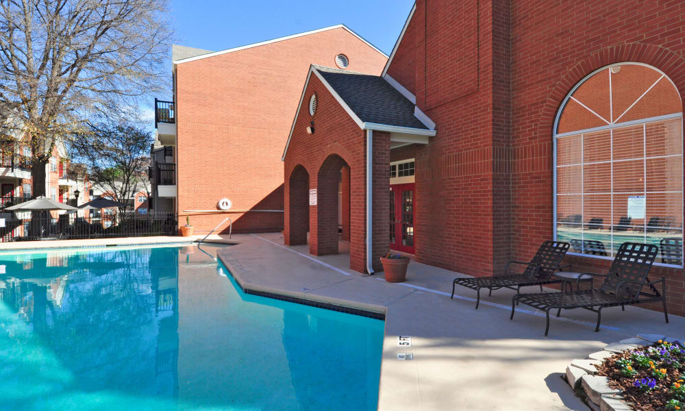 Enjoy a swimming pool with sundeck at Brookwood Valley in Atlanta, Georgia