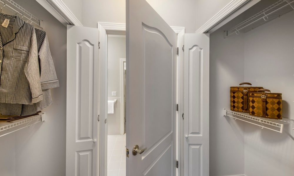 Walk-in closet at The Cove at Riverwinds apartments