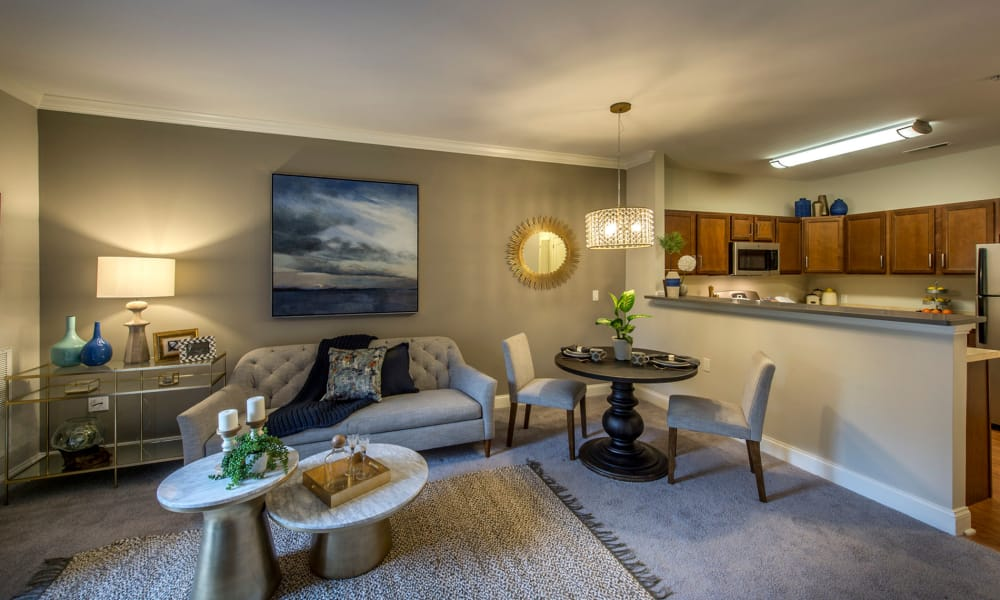 The Cove at Riverwinds showcases a spacious living room and kitchen in West Deptford