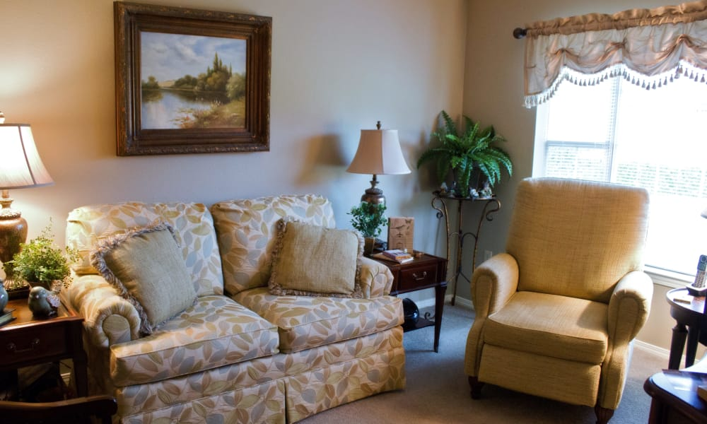 Senior apartment living room at Azalea Estates of Slidell in Slidell, Louisiana