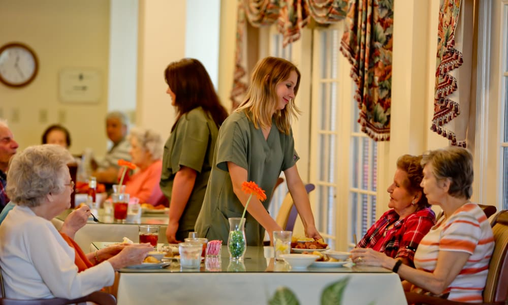 Residents being served by the staff at Azalea Estates of Slidell in Slidell, Louisiana