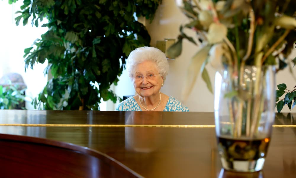 A resident of Azalea Estates of Slidell playing the piano for her peers in Slidell, Louisiana