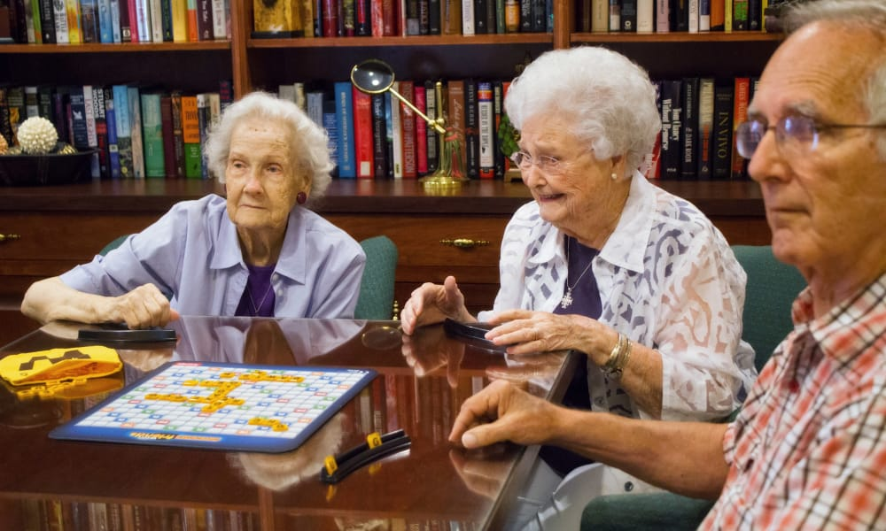 Residents of Azalea Estates of Slidell playing games in the library in Slidell, Louisiana