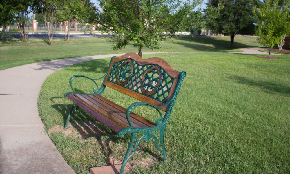 Bench at the outdoor walkway at Azalea Estates of Shreveport