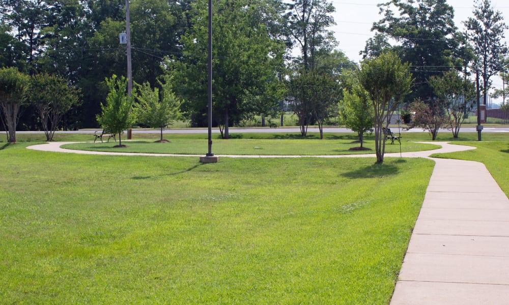 Outdoor walkway going through the grounds of Azalea Estates of Shreveport
