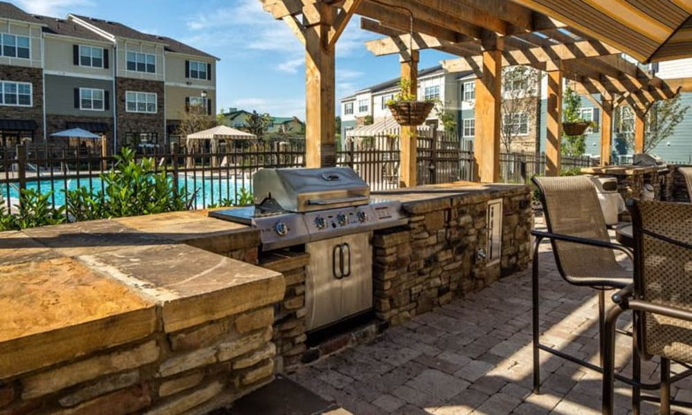 BBQ Grill near swimming pool at Avana Highland Ridge Apartments in Columbus, GA