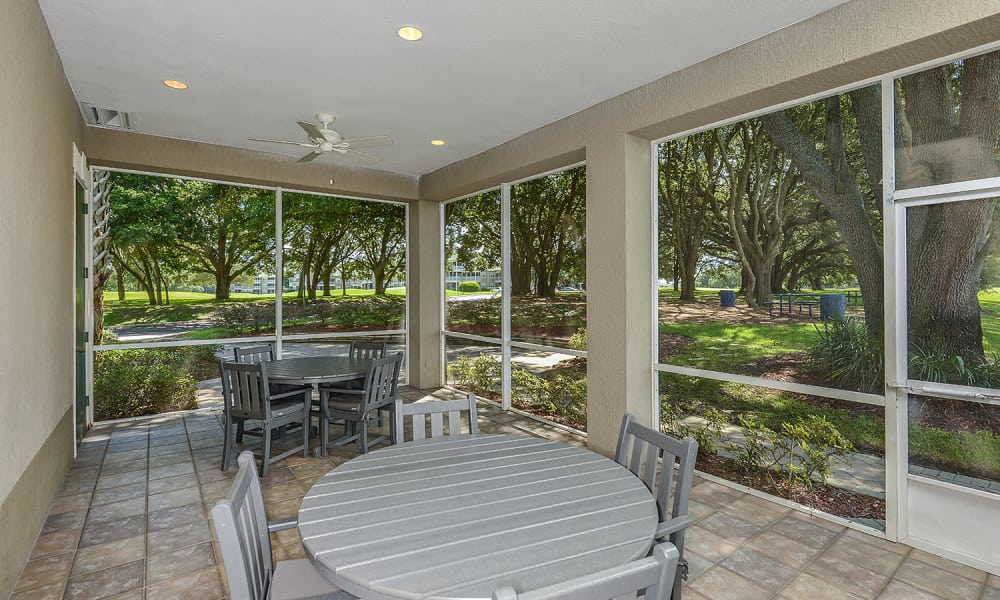 Shaded sunroom at Audubon Oaks in Lakeland, Florida