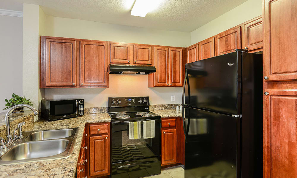 Kitchen with black appliances at Audubon Oaks in Lakeland, Florida
