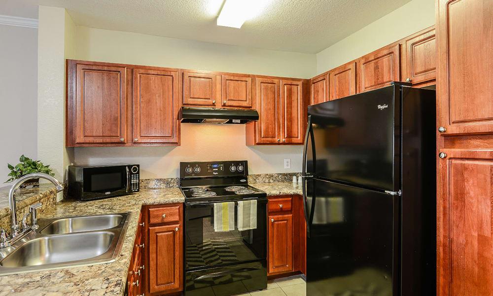 Kitchen with black appliances at Audubon Oaks in Lakeland, Florida