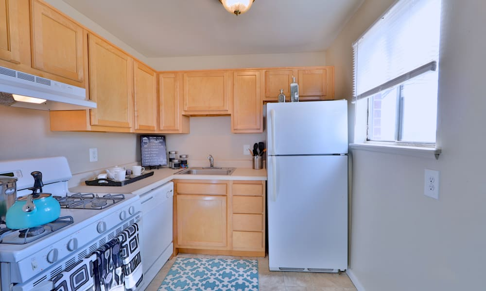 Charlesmont Apartment Homes offers a naturally well-lit kitchen in Dundalk, Maryland