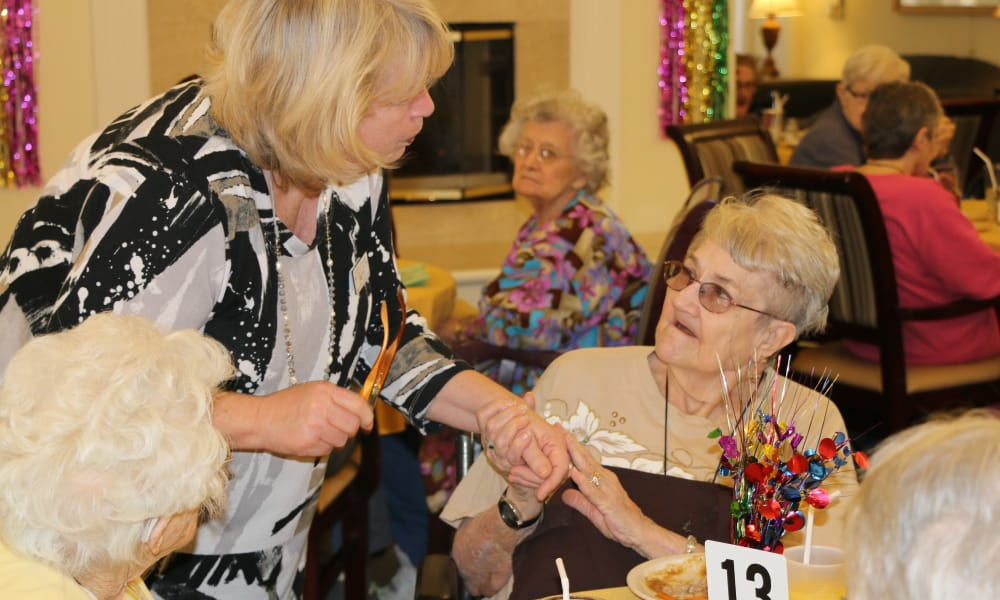Resident talking to a caretaker at Azalea Estates of Slidell in Slidell, Louisiana