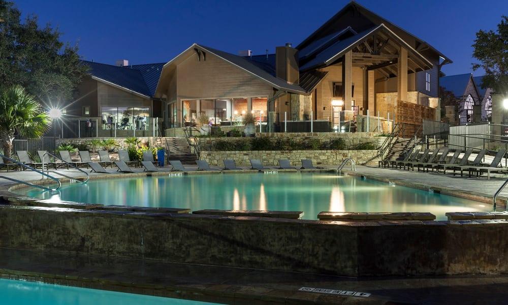 Beautiful night time photo of the pool at Hyde Park at Ribelin Ranch