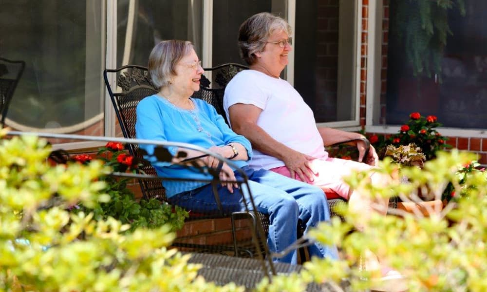 Friends enjoying the sun together at Azalea Estates of Monroe in Monroe, LA
