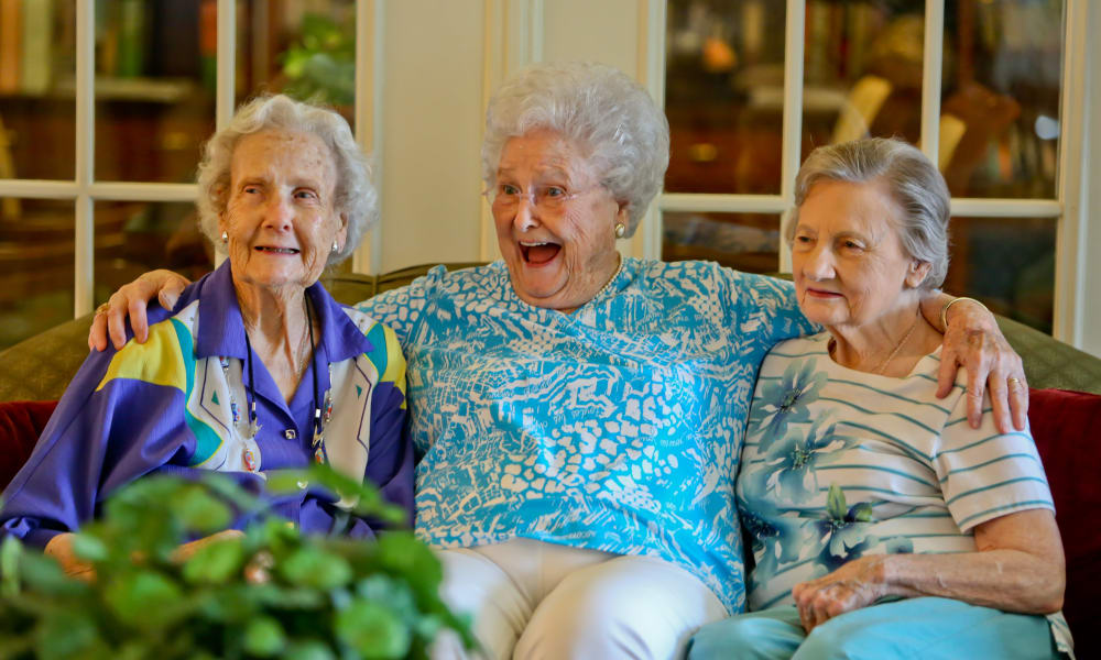3 women on a couch posing for a picture at Azalea Estates of Gonzales in Gonzales, LA