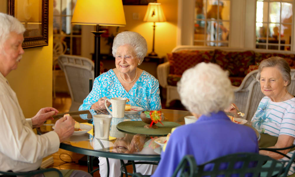 Residents enjoying a meal together at Azalea Estates of Monroe in Monroe, LA