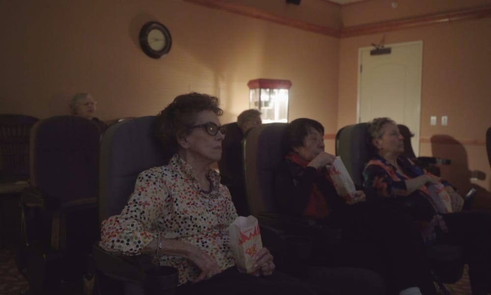 Residents enjoying a film in our on-site cinema at The Fair Oaks in Pasadena, California