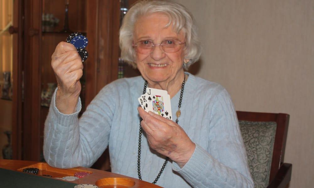 Senior woman playing poker at The Fair Oaks in Pasadena, California
