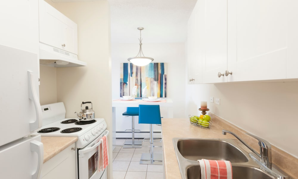 Bright Calgary Place Apartments kitchen