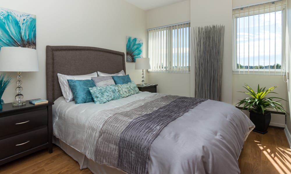 Cozy bedroom at Glenmore Heights apartments in Calgary