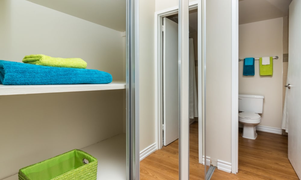 Closet and bathroom at Glenmore Heights apartments in Calgary