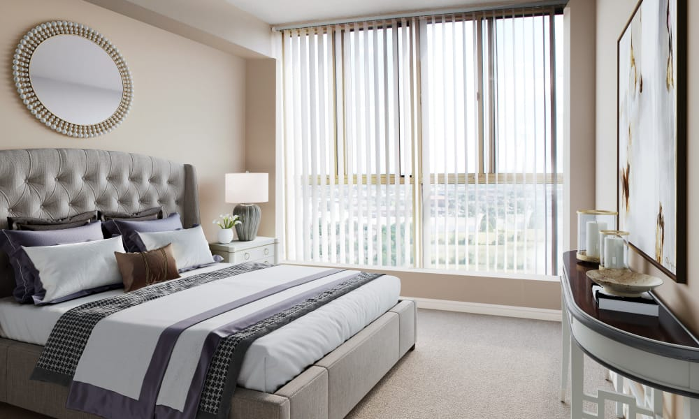 The Waterford Tower showcases a cozy bedroom in Mississauga apartments