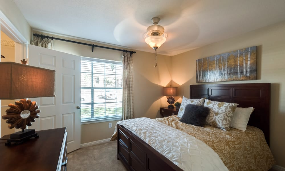 Bedroom with ceiling fan at The Paramount in Houston, Texas