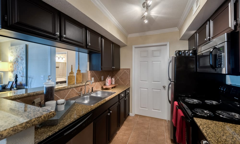 Fully equipped kitchen at The Paramount in Houston, Texas