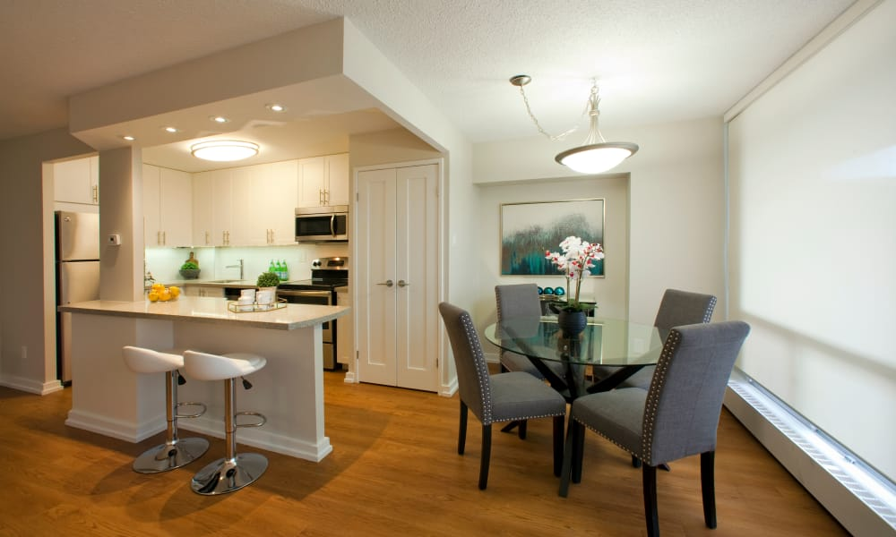 Dining area and kitchen at Richmond Hill Apartments in Richmond Hill, Ontario