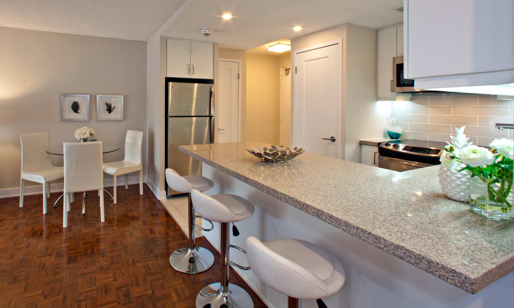 Kitchen with breakfast bar at Residences on Bloor in Toronto
