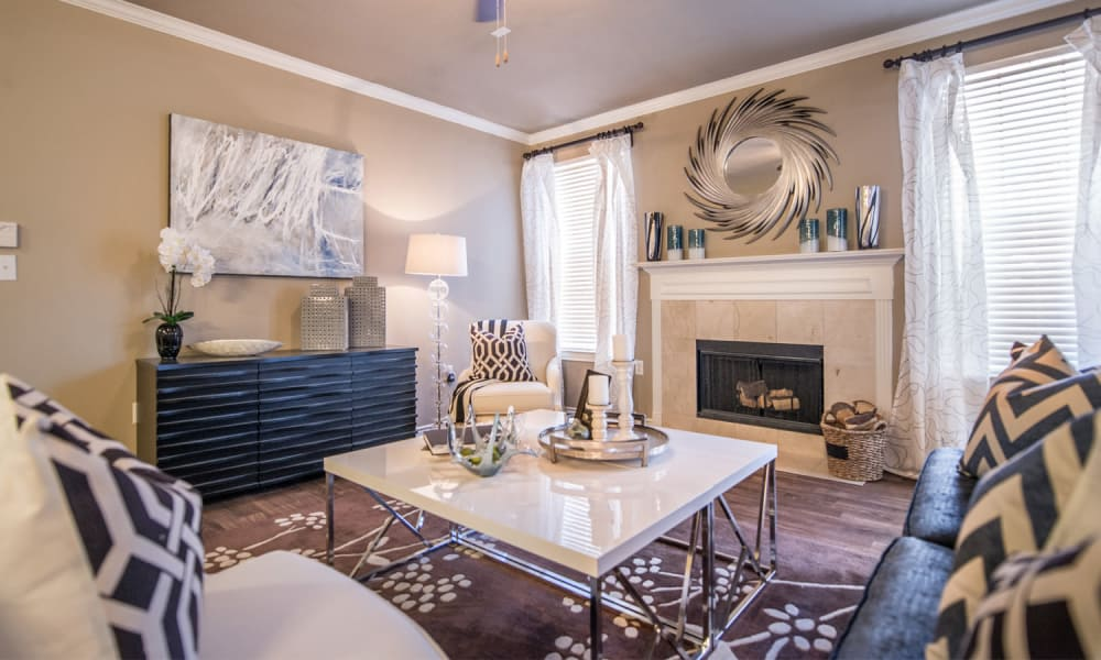 Living room with fireplace at Bella Vida Estates in Plano, TX