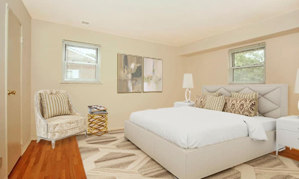 Modern bedroom at Post & Coach Apartment Homes in Freehold, New Jersey