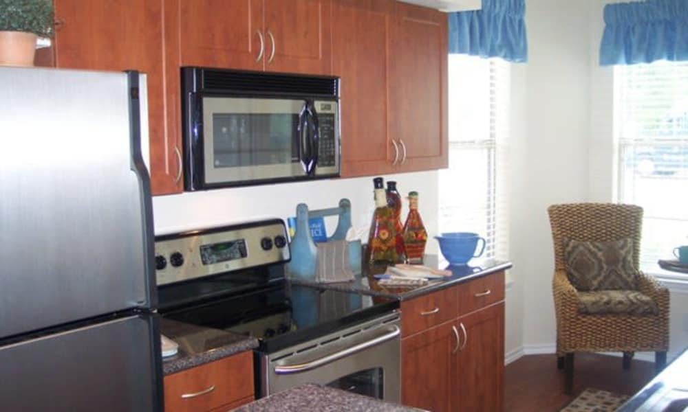 Fully equipped kitchen at Stone Lake Apartments in Grand Prairie, Texas