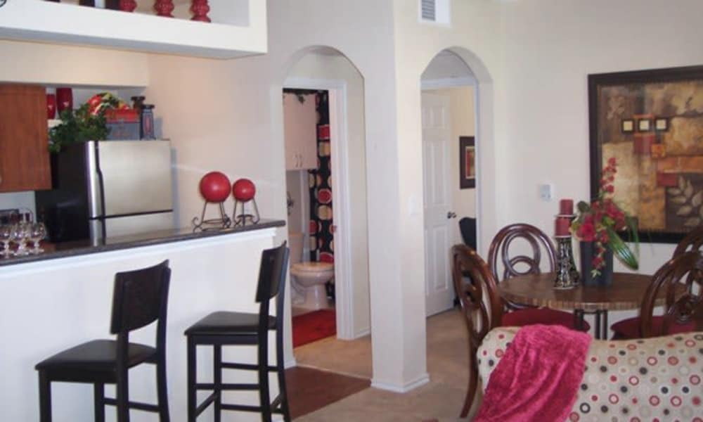 Stone Lake Apartments offers kitchen with breakfast bar in Grand Prairie, Texas