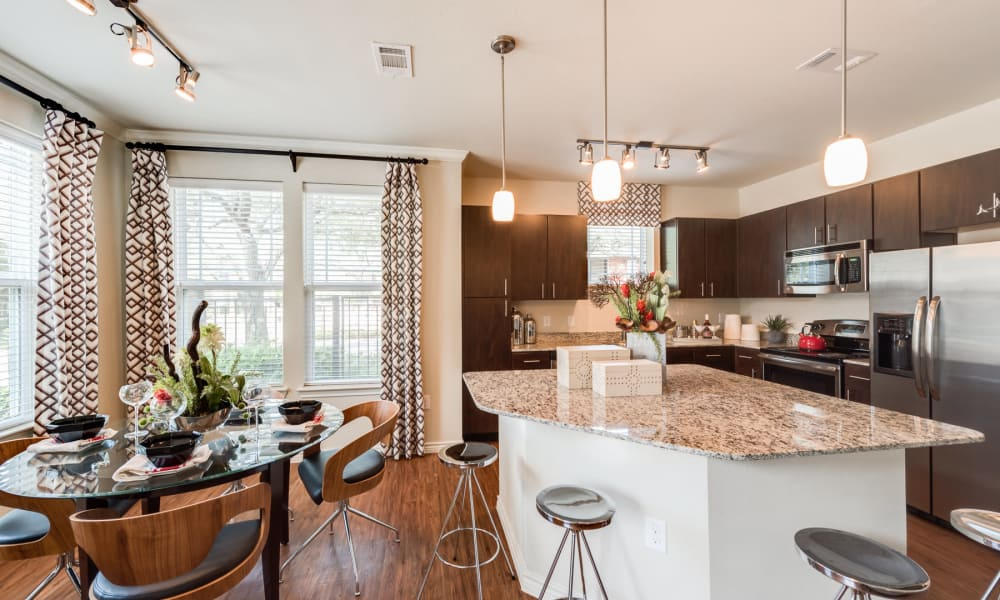 Kitchen and dining room combo at Seventeen15 in Houston, Texas