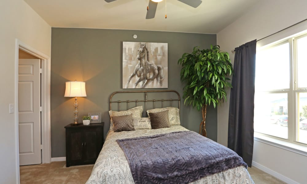 Naturally well-lit bedroom at Longhorn Crossing in Fort Worth, Texas