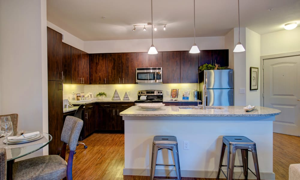Kitchen with breakfast bar at 91 Fifty in Houston, Texas