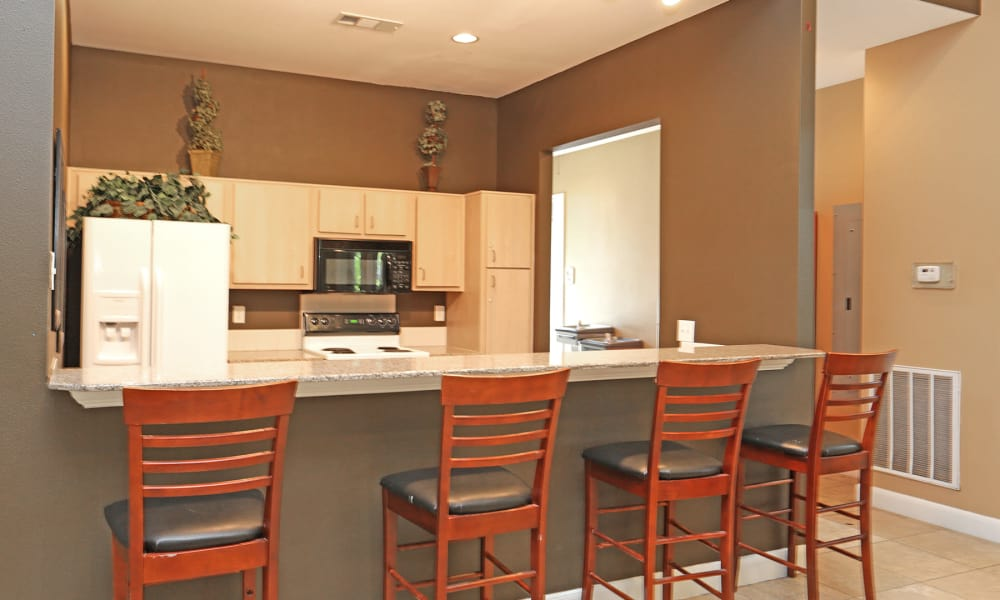 Kitchen with breakfast bar at Ashley House in Katy, Texas