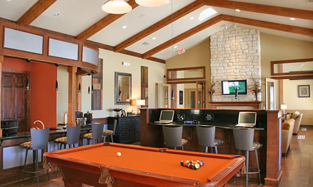 Clubhouse with a billiards table at Club at Stone Oak in San Antonio, Texas