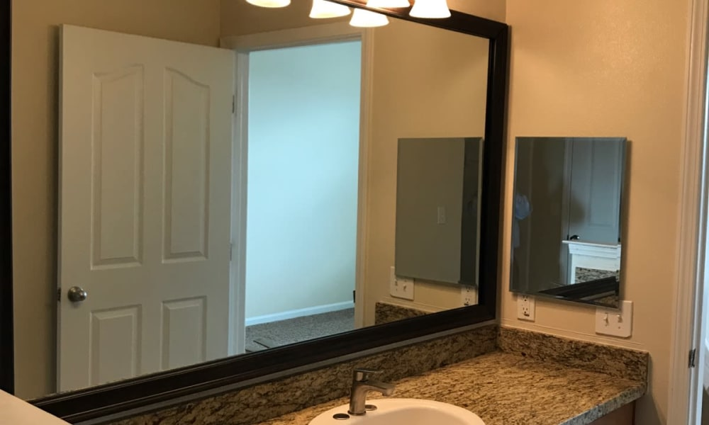 Club at Stone Oak offers bathrooms with large mirror in San Antonio, Texas