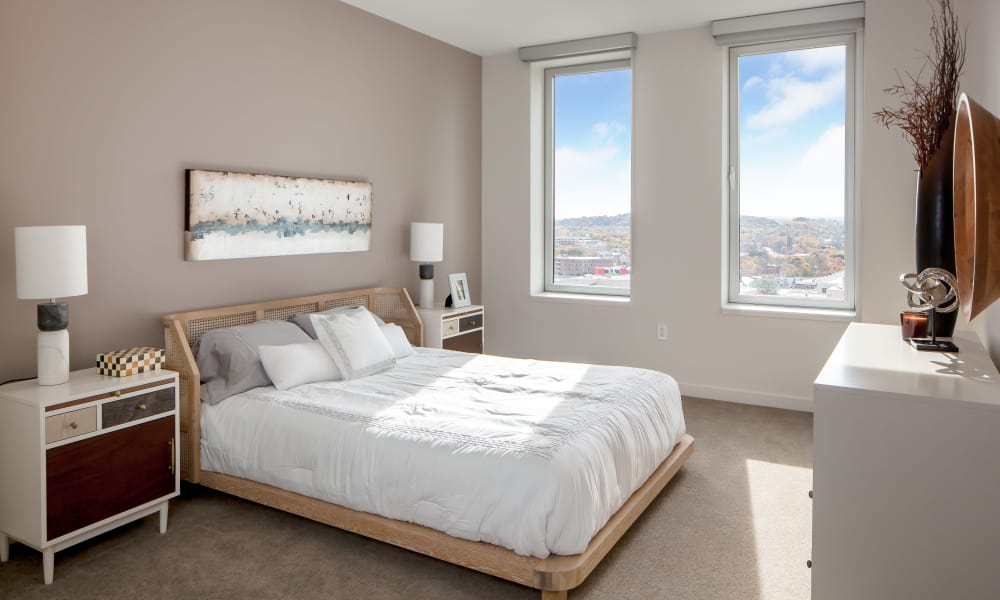 Enjoy natural light in the bedroom at Tower280 in Rochester, NY