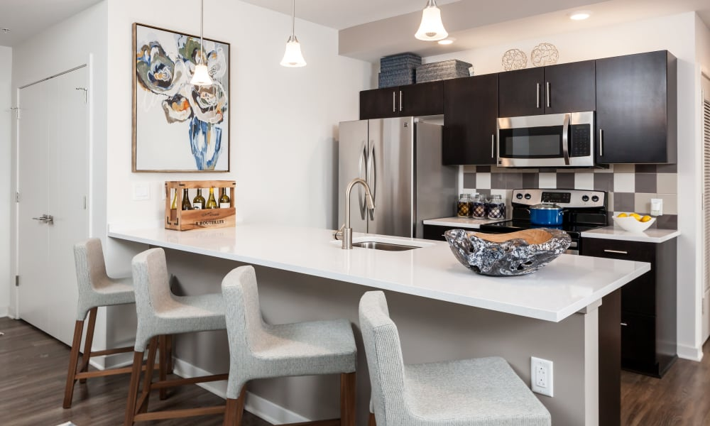 Kitchen with breakfast bar at Tower280 in Rochester, NY