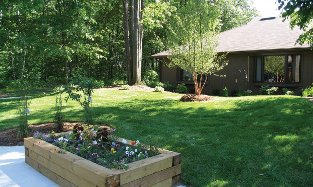 Large lawn with a planter box at Lakeshore Woods in Fort Gratiot, Michigan