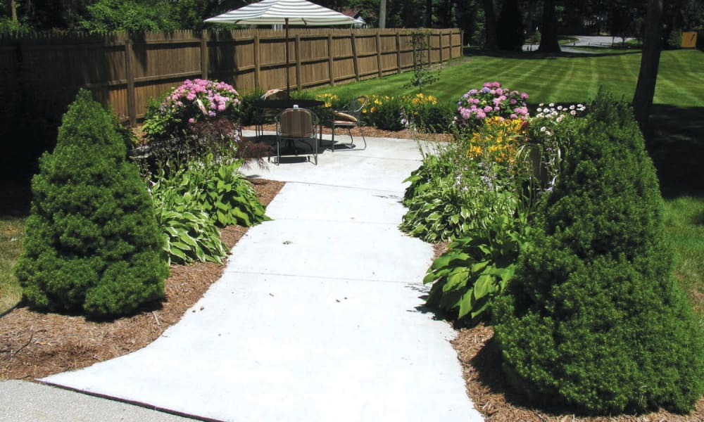 Paved walkway leading to a patio at Lakeshore Woods in Fort Gratiot, Michigan