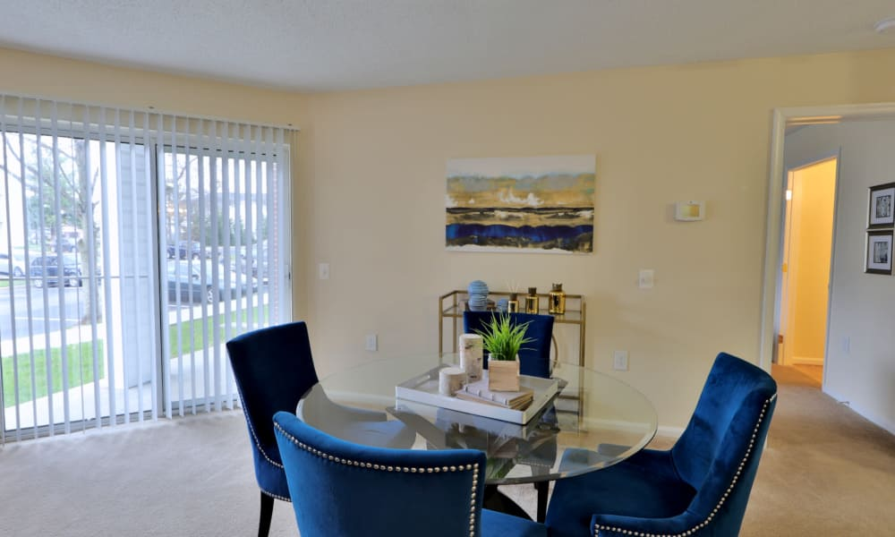 Dining area with patio view at The Apartments at Diamond Ridge in Baltimore, MD